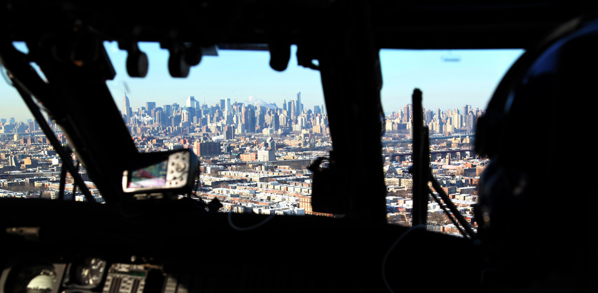US Customs and Border Protection flys a Black Hawk helicopter over the New York City National Gateway to the United States securing America's borders..
