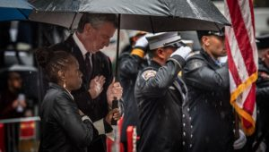 Mayor Bill de Blasio and First Lady Chirlane McCray attend the funeral for U.S. Marine staff sergeant and FDNY firefighter Christopher Slutman