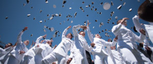 US STRONG – U.S. Naval Academy throw their hats in the air following their 2019 graduation and commissioning ceremony